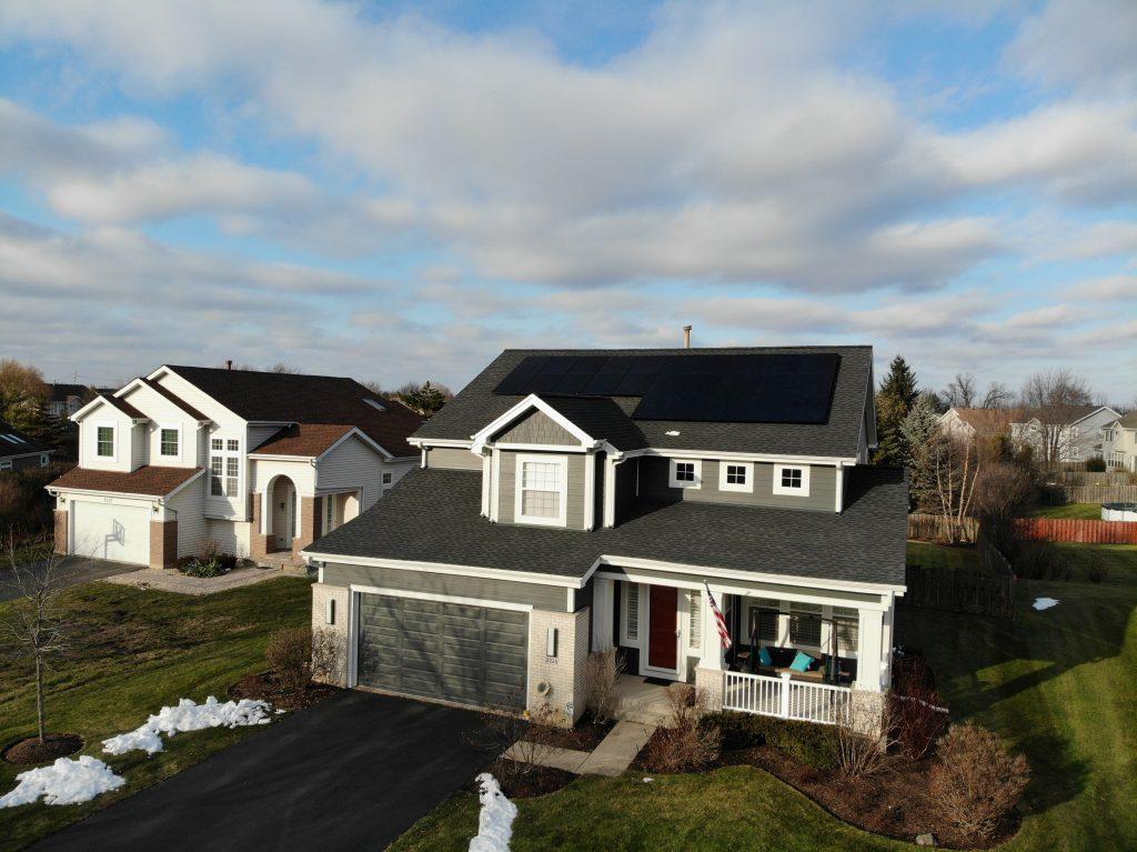 house with solar panels by certasun
